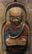 Monk seated holding a rosary and a sutra. first half of the 10th century, Tang dynasty (618-907 AD), the Five Dynasties (907-960 AD). Brick, polychrome terracotta from China