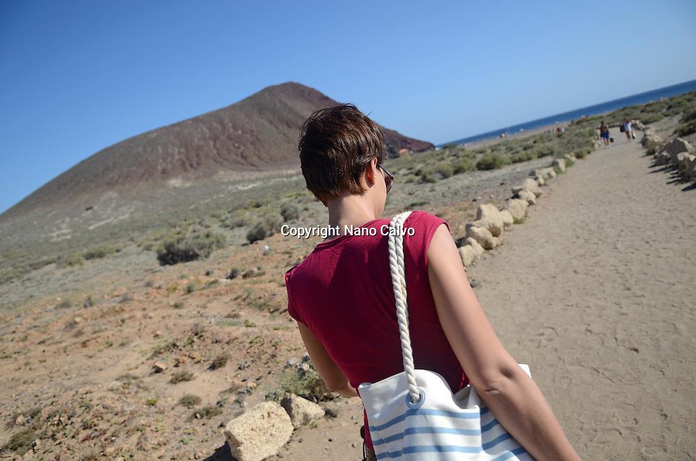 Young woman walking to La Tejita Beach (Playa de la Tejita), Tenerife