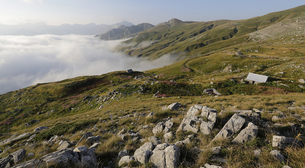 Morning mist raising up from the valle, katun Carine, below the Komovi mountains, Montenegro.  'Katun' is a mountain  summer settlement of pastolarists.