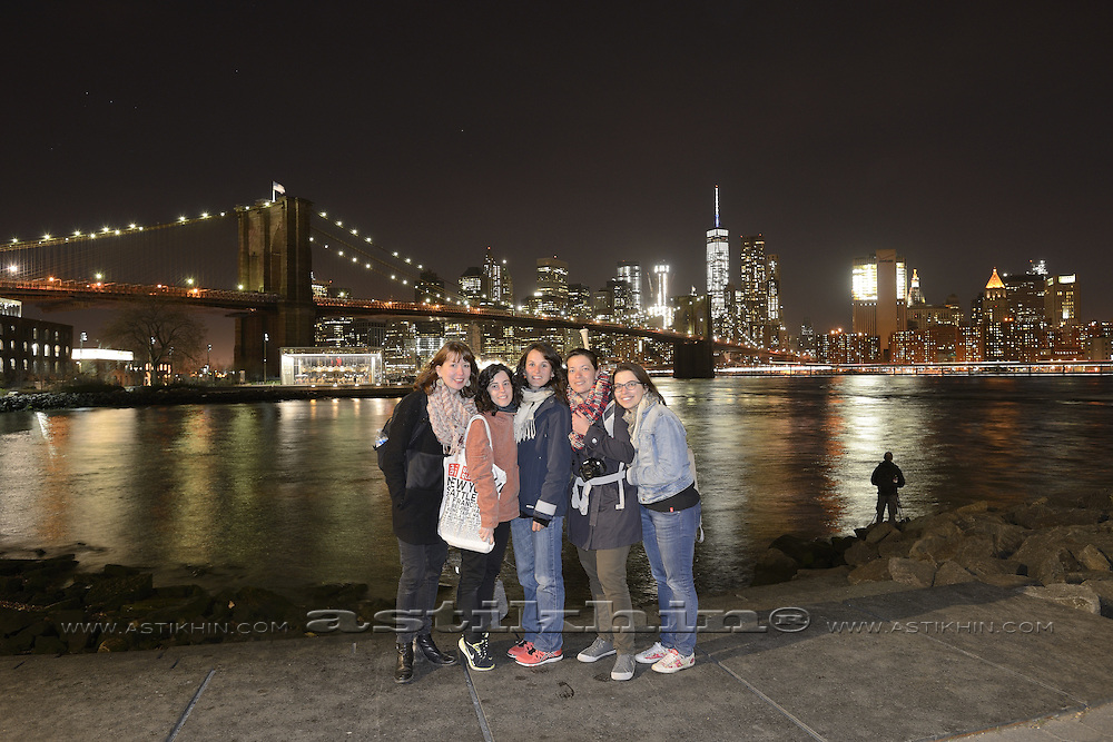 Friends in Brooklyn Bridge Park on East River.