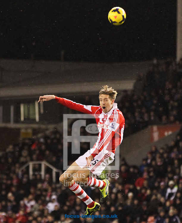 Peter Crouch of Stoke City heads the ball on during the Barclays Premier League match at the Britannia Stadium, Stoke-on-Trent<br /> Picture by Tom Smith/Focus Images Ltd 07545141164<br /> 12/02/2014