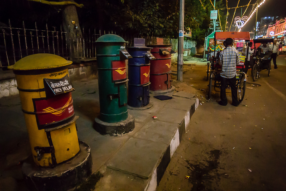 Four colorful postboxes in a street in Jaipur