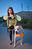 Nine year old, Evelyn DeLarea and her dog Bailey on Halloween evening, Oak Hills, Pittsburg, CA