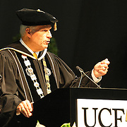 UCF President John Hitt addresses graduates of UCF's College of Health and Public Affairs and the College of Medicine's Burnett School of Biomedical Sciences at the UCF Arena on Thursday, May 2, 2013 in Orlando, Florida.   (AP Photo/Alex Menendez)
