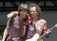 Mick Jagger and Keith Richards of the Rolling Stones get together before a news conference at which they announced the new concert tour. At the Juilliard School of Music in New York Tuesday 10 May 2005.