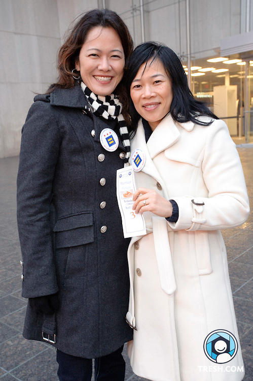 Gwen Migita, left, and Cuc Vu of Washington, pose outside of the Superior Courthouse of the District of Columbia, Washington, D.C., Wednesday, March 3, 2010, holding a ticket that keeps their place as one of the first same-sex couples to legally apply for a District marriage license.