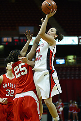 30 December 2010: Emily Hanley puts up a one hand shot with the hand of Latasha Hollingshed in her face during an NCAA Womens basketball game between the Bradley Braves and the Illinois State Redbirds at Redbird Arena in Normal Illinois.