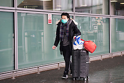 Edinburgh, Scotland, UK. 27 March, 2020. Interior views of a deserted Edinburgh Airport during the coronavirus pandemic. With very few flights during the current Covid-19 crisis passengers are scarce in the terminal building. Passenger wearing a face mask . Iain Masterton/Alamy Live News