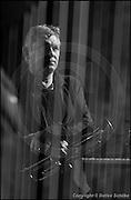 Berlin, DEU, 04.11.2001: Jazz Music , Palle Mikkelborg, Trumpet, Keyboards, hinter den Saiten der Harfe, JazzFest Berlin 2001, Northern Jazzposure, Haus der Berliner Festspiele, Schaperstr.24, Berlin, 04.11.2001 ( Keywords: Musiker ; Musician ; Musik ; Music ; Jazz ; Jazz ; Kultur ; Culture ) ,  [ Photo-copyright: Detlev Schilke, Postfach 350802, 10217 Berlin, Germany, Mobile: +49 170 3110119, photo@detschilke.de, www.detschilke.de - Jegliche Nutzung nur gegen Honorar nach MFM, Urhebernachweis nach Par. 13 UrhG und Belegexemplare. Only editorial use, advertising after agreement! Eventuell notwendige Einholung von Rechten Dritter wird nicht zugesichert, falls nicht anders vermerkt. No Model Release! No Property Release! AGB/TERMS: http://www.detschilke.de/terms.html ]