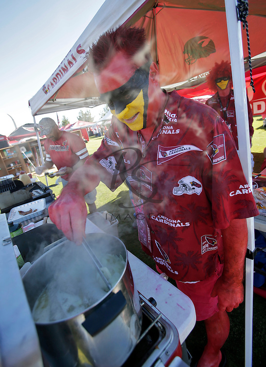 Richard Rader tailgates prior to an NFL football game between the Washington Redskins and the Arizona Cardinals, Sunday, Dec. 4, 2016, in Glendale, Ariz. (AP Photo/Rick Scuteri)
