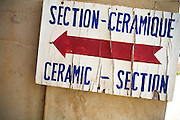 Sign pointing to the ceramic section at the Village Artisanal de Ouagadougou, a cooperative that employs dozens of artisans who work in different mediums, in Ouagadougou, Burkina Faso, on Monday November 3, 2008.