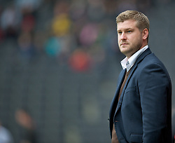 MILTON KEYNES, ENGLAND - Easter Monday, April 9, 2012: Milton Keynes Dons' manager Karl Robinson during the Football League One match against Tranmere Rovers at the Stadium MK. (Pic by David Rawcliffe/Propaganda)