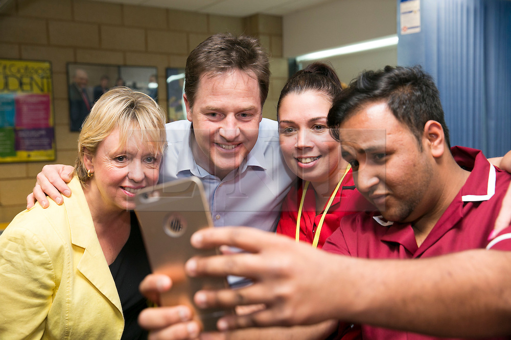 © Licensed to London News Pictures. 01/05/2015. Solihull, West Midlands, UK. Deputy Prime Minister Nick Clegg visiting Solihull College to meet Health and Social Care students. Pictured, Nick Clegg has a selfie with Fahad Bhimji, Emma Mutton and Loreley Burt, left. Photo credit : Dave Warren/LNP