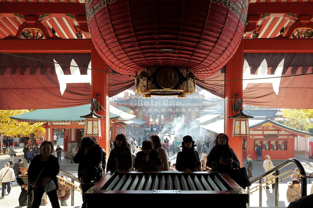 worshipers at the Asakusa Kannon Temple Tokyo