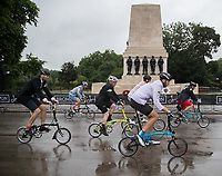 A view of the riders in the Brompton World Championship Final as they pass a World War One Memorial at Prudential RideLondon  29/07/2017<br /> <br /> Photo: Jed Leicester/Silverhub for Prudential RideLondon<br /> <br /> Prudential RideLondon is the world's greatest festival of cycling, involving 100,000+ cyclists – from Olympic champions to a free family fun ride - riding in events over closed roads in London and Surrey over the weekend of 28th to 30th July 2017. <br /> <br /> See www.PrudentialRideLondon.co.uk for more.<br /> <br /> For further information: media@londonmarathonevents.co.uk