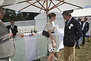 Mischa Barton and Arnaud Bamberger, Cartier International Polo. Guards Polo Club. Windsor Great Park. 30 July 2006. ONE TIME USE ONLY - DO NOT ARCHIVE  © Copyright Photograph by Dafydd Jones 66 Stockwell Park Rd. London SW9 0DA Tel 020 7733 0108 www.dafjones.com