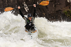 An unidentified whitewater kayaker raises their paddle in jubilation after kayaking through the rapids at Pillow Rock on the Gauley River during American Whitewater's Gauley Fest weekend. The upper Gauley, located in the Gauley River National Recreation Area is considered one of premier whitewater rivers in the country.