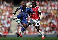Photo: Lee Earle.<br /> Arsenal v Portsmouth. The FA Barclays Premiership. 02/09/2007.Portsmouth's Noe Pamarot (L) battles with Emmanuel Adebayor.