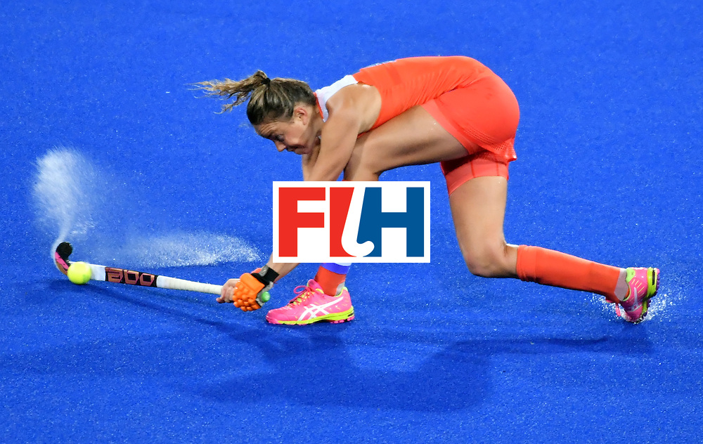 Netherland's Maartje Paumen hits the ball during the women's quarterfinal field hockey Netherland vs Argentina match of the Rio 2016 Olympics Games at the Olympic Hockey Centre in Rio de Janeiro on August 15, 2016.  / AFP / Pascal GUYOT        (Photo credit should read PASCAL GUYOT/AFP/Getty Images)