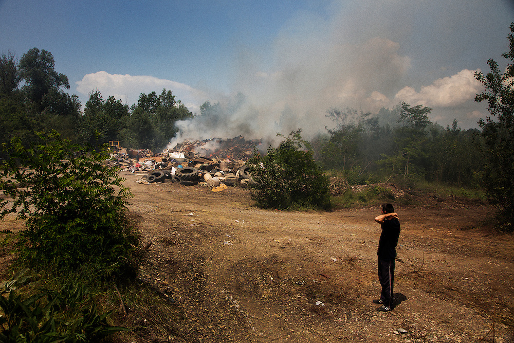 A worker looks at a burning pile of flooding debris from the Bosnian city of Samac.<br /> <br /> Photo by Matt Lutton / Boreal Collective<br /> <br /> Flooding in Bosnia and Herzegovina.