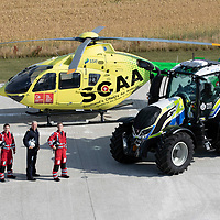 SCAA…Scotland's Charity Air Ambulance 'Helimed 76' pictured with Police Scotland's tractor ahead of the Perth Show on the 4/5th August…The tractor has been loaned to Police Scotland Specialist Crime Division who are responsible for rural and agricultural crimes, pictured from left paramedic Darren O'Brien, Captain Paul Ramsden and paramedic Rich Garside<br />