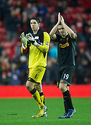 16.03.2013, St. Marys Stadion, Southampton, ENG, Premier League, FC Southampton vs FC Liverpool, 30. Runde, im Bild Liverpool's goalkeeper Brad Jones and Stewart Downing walk off dejected as their side lose 3-1 to Southampton during during the English Premier League 30th round match between Southampton FC and Liverpool FC at the St. Marys Stadium, Southampton, Great Britain on 2013/03/16. EXPA Pictures © 2013, PhotoCredit: EXPA/ Propagandaphoto/ David Rawcliffe..***** ATTENTION - OUT OF ENG, GBR, UK *****