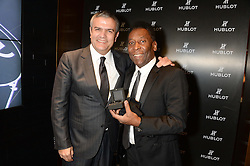 Pele arrived at the Hublot store in New Bond Street prior to accepting the<br /> HMV Football Extravaganza Lifetime achievement award. In celebration of<br /> Pele's birthday Ricardo Guadalupe , CEO, Hublot presented the ledgendary<br /> footballer with a pair of Hublot All black carbon cuff links - 29th October 2013.<br /> Picture shows:-Ricardo Guadalupe , CEO, Hublot and Pele.