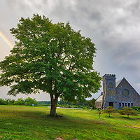 Rain and sunshine formed this beautiful rainbow across the abandoned Old Stone Church and Wachusett Reservoir in West Boylston, Massachusetts shortly before the storm at sunset. This National Historic Site is located on the banks of the Wachusett Reservoir in Worchester County, Central Massachusetts.<br />