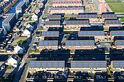 Noord-Holland, Gemeente Heerhugowaard, 11-12-2013; Stad van de Zon (Sun City), nieuwbouwwijk op VINEX lokatie, in de Polder Heerhugowaard tussen de dorpskern van Heerhugowaard en Alkmaar. Milieuvriendelijke wijk met energiezuinige huizen die bovendien uitgerust zijn met zonne-energie panelen.<br /> Sun City, new housing estate in Northwest of the Netherlands with energy neutral and environmetal friendly houses, equiped with individual solar panels.<br /> luchtfoto (toeslag op standaard tarieven);<br /> aerial photo (additional fee required);<br /> copyright foto/photo Siebe Swart.