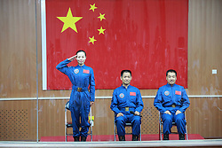 59797603 <br /> The three astronauts of the Shenzhou-10 manned spacecraft mission, Nie Haisheng (C), Zhang Xiaoguang (R) and Wang Yaping, meet the media at the Jiuquan Satellite Launch Center in Jiuquan, northwest China s Gansu Province, June 10, 2013. The Shenzhou-10 manned spacecraft will be launched at the Jiuquan Satellite Launch Center at 5:38 p.m. Beijing Time (0938 GMT) June 11.<br /> UK ONLY