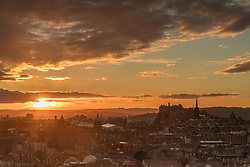 The sun sets over Edinburgh