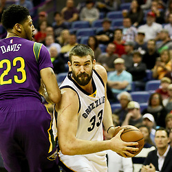 Feb 1, 2016; New Orleans, LA, USA; Memphis Grizzlies center Marc Gasol (33) drives past New Orleans Pelicans forward Anthony Davis (23) during the first quarter of a game at the Smoothie King Center. Mandatory Credit: Derick E. Hingle-USA TODAY Sports
