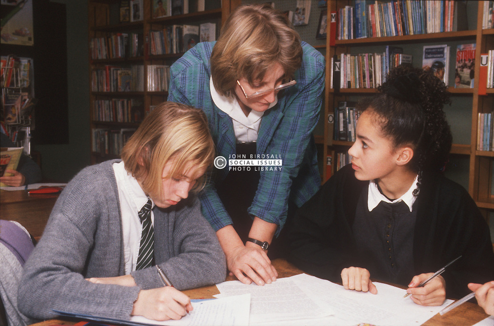 Teacher and secondary school pupils in classroom,