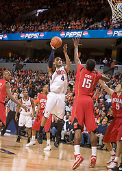 Virginia guard Calvin Baker (4) shoots over Maryland forward James Gist (15).  The Virginia Cavaliers defeated the Maryland Terrapins 91-76 at the University of Virginia's John Paul Jones Arena  in Charlottesville, VA on March 9, 2008.