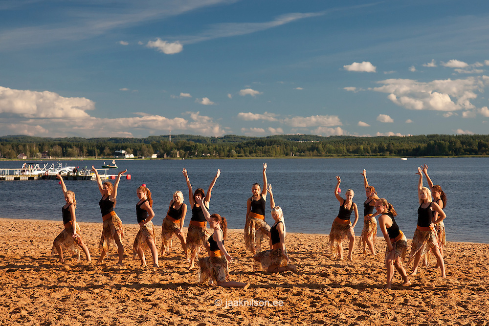 Teenage Girls Dancing on Beach, Lake Tamula in Võru, Estonia