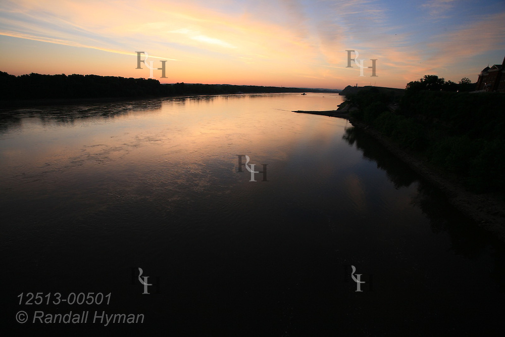 Dawn sky reflects in smooth waters of Missouri River at Hermann, Missouri.