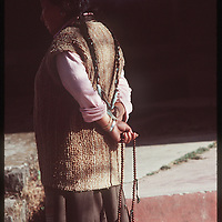 Photo by David Stephenson.  A Tibetan woman holds a set of prayer beads in Dharamsala, India, in 11/91.