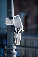 A scarf wrapped around a lightpole in Rotary Park.  (Karen Bobotas/for the Laconia Daily Sun)
