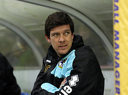 Bristol Rovers Manager Darrell Clarke takes his seat in the dugout - Mandatory byline: Robbie Stephenson/JMP - 07966 386802 - 26/12/2015 - FOOTBALL - Kingsmeadow Stadium - Wimbledon, England - AFC Wimbledon v Bristol Rovers - Sky Bet League Two