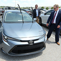 Dr. Jay Allen, Itwamba Community College President, and Tyler Camp, Special Assistant to the President, look ove one the 10 Toyota Corolla's that were donated to ICC by Toyota Mississippi at the Blue Springs plant on Wednesday afternoon. The vehicles will be used to further support community college career and technology programs.