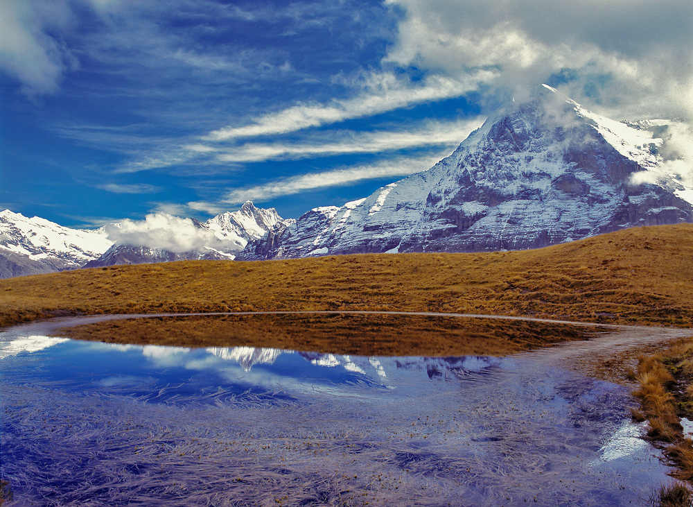The Eiger reflects in a small tarn in the Berner Oberland in Switzerland.