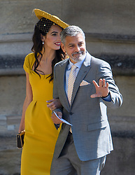© Licensed to London News Pictures. 19/05/2018. London, UK. GEORGE AND AMAL CLOONEY. Guests arrive at The wedding of Prince Harry, The Duke of Sussex to Meghan Markle, The Duchess of Sussex, at St George's Chapel in Windsor. Photo credit: Ben Cawthra/LNP