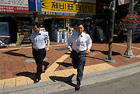 Businessmen in Euljiro district, Seoul, South Korea. 2009