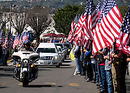 A police motorcycle leads the hearse carrying the body of Whittier Police Officer Keith Boyer arrives at Rose Hills Memorial Park in Whittier, Calif., Friday, March 3, 2017. Boyer, who was fatally shot after responding to a traffic crash, was remembered today by thousands of law enforcement officers, friends and family as a dedicated public servant, talented drummer, loving friend and even a ``goofy'' dad.(Photo by Ringo Chiu/PHOTOFORMULA.com)<br />