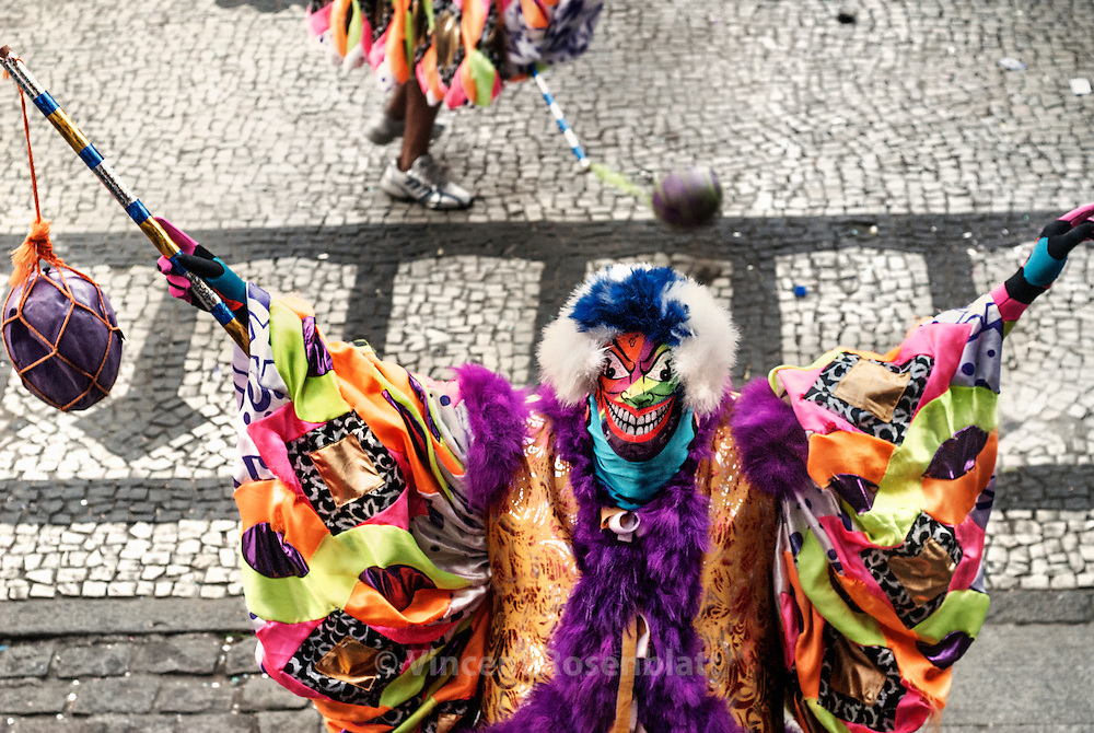 "Great competition for the best ""Bate Bola"" costume in the center of Rio de Janeiro. Some gangs carry their ""hit-the-ball"", when others prefered a soft toy or an umbrella as a sign of pacifism. The costume can coast until 600 USD$ to prepare, representing more than 3 times the minimum salary in Brazil.."