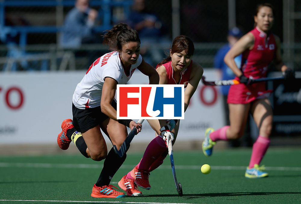 JOHANNESBURG, SOUTH AFRICA - JULY 14: Marlena Rybacha of Poland and Minami Shimizu of Japan battle for possession during day 4 of the FIH Hockey World League Semi Finals Pool B match between Poland and Japan at Wits University on July 14, 2017 in Johannesburg, South Africa. (Photo by Jan Kruger/Getty Images for FIH)