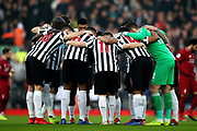 Newcastle United do the huddle before the Premier League match between Liverpool and Newcastle United at Anfield, Liverpool, England on 26 December 2018.