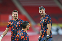 Football - 2020 / 2021 EFL Cup - Round 2 -Southampton vs. Brentford <br /> <br /> Southampton's Fraser Forster (right) and Harry Lewis (left) share a joke with Southampton's Alex McCarthy before they start there pre match warm up at St Mary's Stadium Southampton<br /> <br /> COLORSPORT/SHAUN BOGGUST