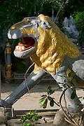 Phnom Penh, Cambodia. Wat Botum. Guarding lion.