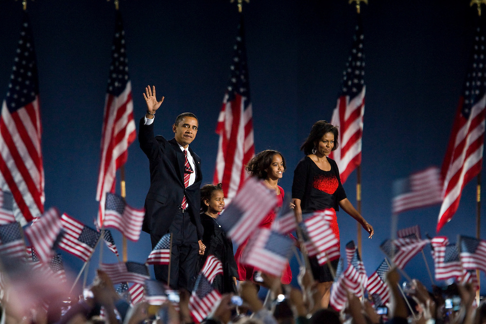 Nov 04, 2008 - Chicago, Illinois, USA - BARACK OBAMA waves on stage with MICHELLE OBAMA at Grant Park after becoming the country's first black president. Thousands of people attended the historic event at Grant Park in Chicago.   © 2012 Patrick T. Fallon